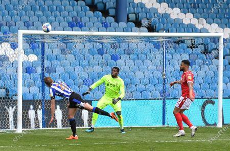 Jordan Rhodes of Sheffield Wednesday puts his header over the goal