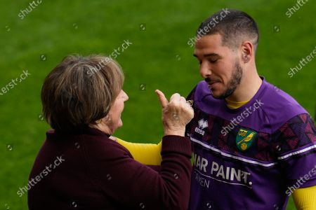Emi Buendía of Norwich City (17) hugs Norwich City Joint Majority Shareholder Delia Smith before collecting his player of the season award