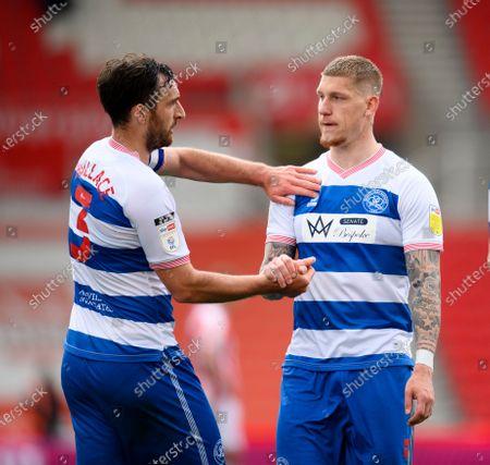 Jordy de Wijs of Queens Park Rangers shakes hands with Lee Wallace of Queens Park Rangers.