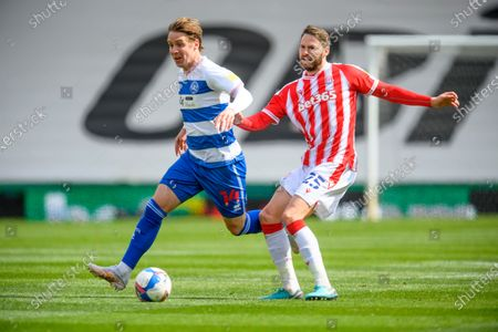 Stefan Johansen of Queens Park Rangers is challenged by Nick Powell of Stoke City.