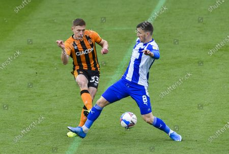 Greg Docherty of Hull City and Lee Evans of Wigan Athletic