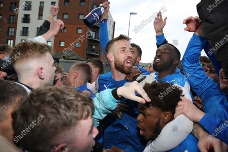 Mark Beevers of Peterborough United  celebrates with fans