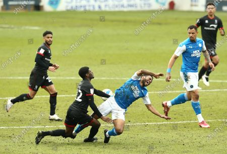 Stock Photo of Nathan Thompson of Peterborough United  is fouled by Timothy Eyoma of Lincoln City