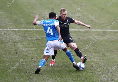 Nathan Thompson of Peterborough United  and Anthony Scully of Lincoln City