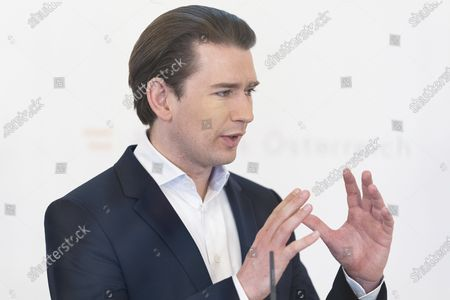 Austrian Chancellor Sebastian Kurz speaks during a press conference behind plexiglass shields at the federal chancellery in Vienna, Austria, . The Austrian government informs about the government's 'Sprungbrett' program for the long-term unemployed and job opportunities through the creation of 'green jobs