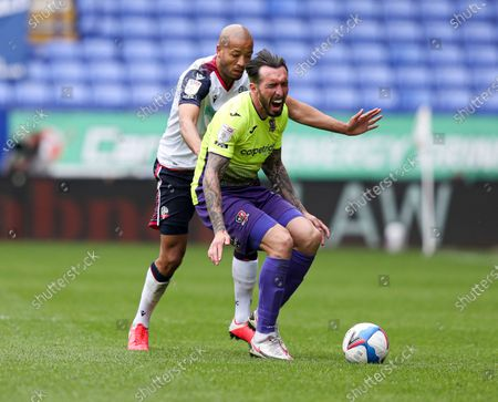 Alex John-Baptiste of Bolton Wanderers and Ryan Bowman of Exeter City