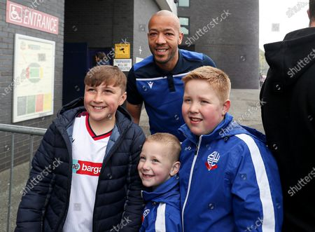 Alex John-Baptiste of Bolton Wanderers with fans outside the stadium