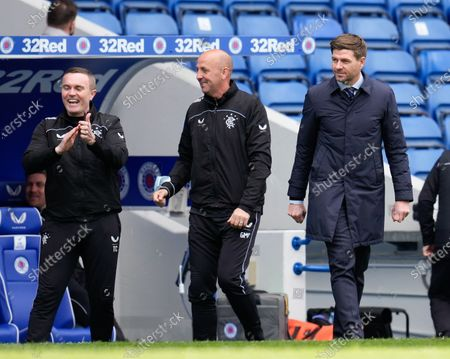 Rangers first team coach Tom Culshaw, Rangers Assistant Manager Gary McAllister & Manager Steven Gerrard celebrate as Kemar Roofe of Rangers scores to give Rangers a 3-1 lead