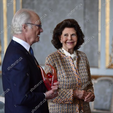 Queen Silvia of Sweden looks on as King Carl XVI Gustaf of Sweden receives a gift on his 75th birthday at The Royal Palace in Stockholm, Sweden, 30 April 2021. The King and Queen Silvia celebrate in a limited form in the royal palace due to the ongoing coronavirus pandemic.