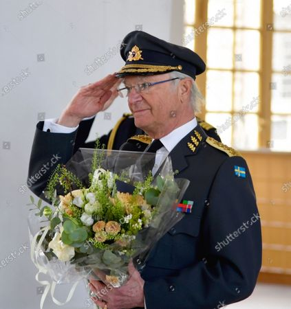 King Carl XVI Gustaf of Sweden holds flowers and salutes as he celebrates his 75th birthday at The Royal Palace in Stockholm, Sweden, 30 April 2021. The King and Queen Silvia celebrate in a limited form in the palace due to the ongoing coronavirus pandemic.