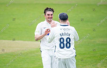 Yorkshire's Jordan Thompson celebrates dismissing Northamptonshire's Luke Proctor with Harry Brook.