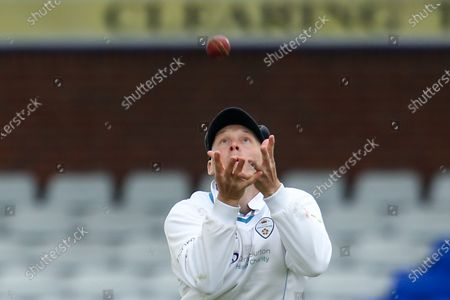 Tom Wood of Derbyshire takes a catch