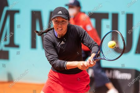 Stock Picture of US tennis player Jessica Pegula in action against Sorana Cirstea of Romania during their Mutua Madrid Open tournament's first round match at Caja Magica complex, in Madrid, Spain, 30 April 2021.