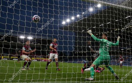Stock Photo of Michail Antonio of West Ham United beats Nick Pope of Burnley to score a second goal and make it 1-2