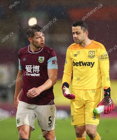 Lukasz Fabianski of West Ham United speaks with James Tarkowski of Burnley at full-time