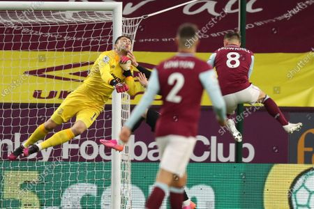 West Ham goalkeeper Lukasz Fabianski saves from Josh Brownhill of Burnley