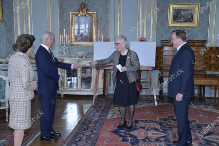 Queen Silvia of Sweden looks on as King Carl Gustaf of Sweden receives a gift from the First Vice Chairman of the Parliament, Åsa Lindestam and Prime Minister Stefan Löfven on his 75th birthday at The Royal Palace in Stockholm, Sweden on Friday, April 30, 2021. The gift, a plaster plaque of the king, will be hung in the Swedish Parliament.