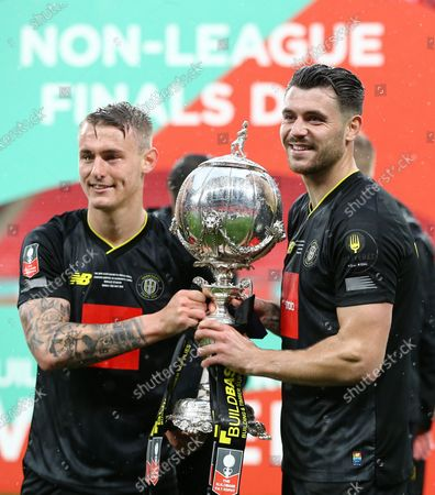 Will Smith  and Connor Hall of Harrogate Town celebrate with the winners trophy