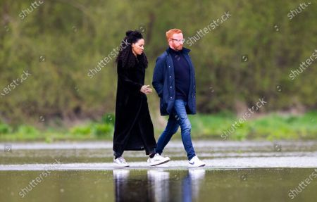 Michelle Ackerley (Loose Women TV presenter) & partner Ben Ryan (International Rugby Coach - England & Fiji) out and about. People, dogs and cyclists appear to walk on water as they traverse a flooded part of Old Deer Park, as the tidal River Thames breaches its banks.