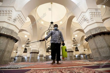 Worker disinfects Al- Jaffali mosque ahead of Friday prayer in an effort to contain the outbreak of the coronavirus during the Muslim fasting month of Ramadan, in Jiddah, Saudi Arabia