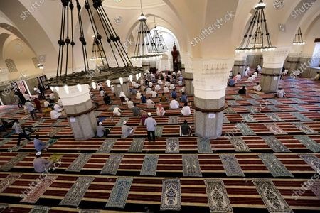 Muslims perform Friday prayer as they practice social distancing to curb the spread of the new coronavirus, at Al- Jaffali mosque during the Muslim fasting month of Ramadan, in Jiddah, Saudi Arabia