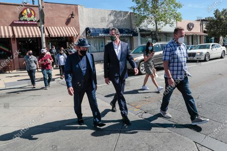 San Fernando, CA, Thursday, April 29, 2021 - California Governor Gavin Newsom tours businesses downtown with Actor Danny Trejo, left, before signing legislation at a press conference. (Robert Gauthier/Los Angeles Times)