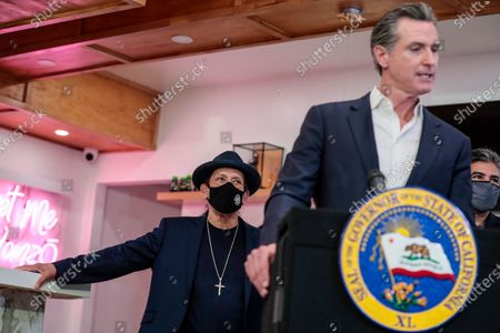 San Fernando, CA, Thursday, April 29, 2021 - Actor Danny Trejo looks on as California Governor Gavin Newsom speaks at a press conference where he signed legislation that will provide a $6.2 billion tax cut to the hardest hit small businesses in the state at Hanzo Sushi restaurant downtown. (Robert Gauthier/Los Angeles Times)