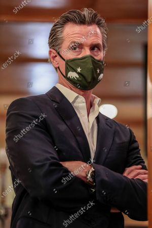 Stock Image of San Fernando, CA, Thursday, April 29, 2021 - California Governor Gavin Newsom at a press conference where he signed legislation that will provide a $6.2 billion tax cut to the hardest hit small businesses in the state at Hanzo Sushi restaurant downtown. (Robert Gauthier/Los Angeles Times)
