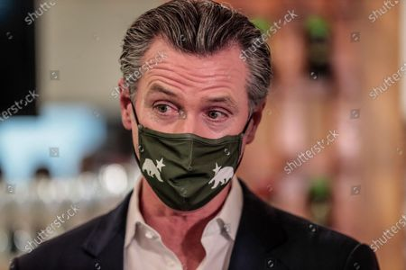 San Fernando, CA, Thursday, April 29, 2021 - California Governor Gavin Newsom at a press conference where he signed legislation that will provide a $6.2 billion tax cut to the hardest hit small businesses in the state at Hanzo Sushi restaurant downtown. (Robert Gauthier/Los Angeles Times)