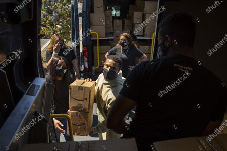 Editorial image of Actor Michael B. Jordan helps Amazon Fresh store associates load care packages for Veterans, in promotion of his new film, Tom Clancy's Without Remorse, Amazon Fresh Store, Los Angeles, California, United States - 29 Apr 2021