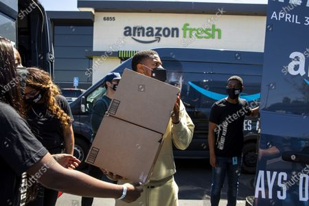"""Stock Photo of Actor Michael B. Jordan joined Amazon Fresh store associates and nonprofit partner Village for Vets in loading care packages of food and household items at the Ladera Heights neighborhood store in Los Angeles, CA, during promotion of the launch of """"Tom Clancy's Without Remorse,"""" on Prime Video, Thursday, April 29, 2021. The program reaches over 600 veterans across Los Angeles. The film is available on Amazon's Prime Video April 30, 2021. (Jay L. Clendenin / Los Angeles Times)"""