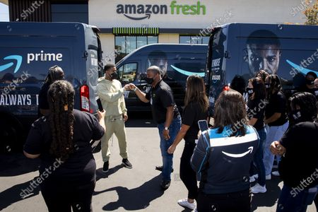 """Amazon Fresh store associates and nonprofit partner Village for Vets volunteers posed for photos with actor Michael B. Jordan, who stopped by during promotion of the launch of """"Tom Clancy's Without Remorse,"""" on Prime Video, to help load care packages of food and household items at the Ladera Heights neighborhood store in Los Angeles, CA, Thursday, April 29, 2021. The program reaches over 600 veterans across Los Angeles. The film is available on Amazon's Prime Video April 30, 2021. (Jay L. Clendenin / Los Angeles Times)"""