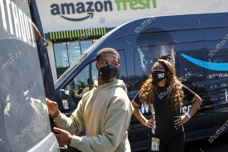 Editorial photo of Actor Michael B. Jordan helps Amazon Fresh store associates load care packages for Veterans, in promotion of his new film, Tom Clancy's Without Remorse, Amazon Fresh Store, Los Angeles, California, United States - 29 Apr 2021