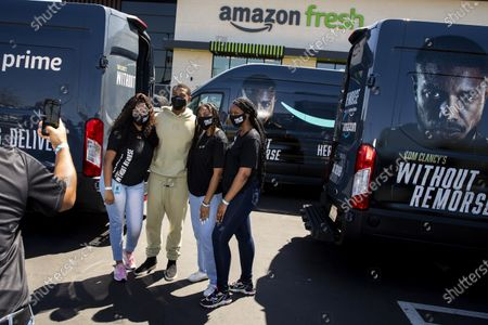 """Stock Image of Amazon Fresh store associates and nonprofit partner Village for Vets volunteers posed for photos with actor Michael B. Jordan, who stopped by during promotion of the launch of """"Tom Clancy's Without Remorse,"""" on Prime Video, to help load care packages of food and household items at the Ladera Heights neighborhood store in Los Angeles, CA, Thursday, April 29, 2021. The program reaches over 600 veterans across Los Angeles. The film is available on Amazon's Prime Video April 30, 2021. (Jay L. Clendenin / Los Angeles Times)"""