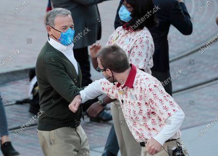 Editorial image of Disneyland CEO Bob Iger elbow bumps a cast member as the theme park gets ready to receive guest for the first time in more than a year on Friday, April 30, 2021, Anaheim, California - 30 Apr 2021
