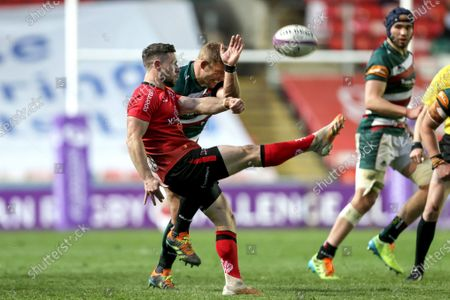 Stock Image of Leicester Tigers vs Ulster. Ulster's John Cooney clears the ball despite Tom Youngs of the Leicester Tigers