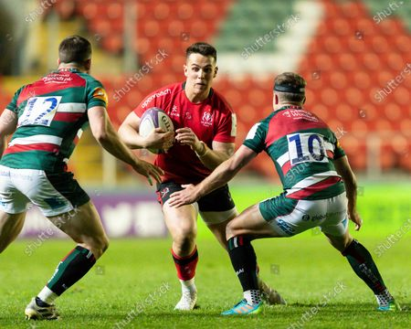 Ethan McIlroy of Ulster Rugby is challenged by George Ford and Matt Scott of Leicester Tigers