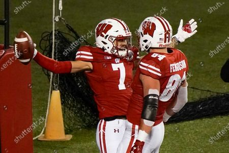 Wisconsin wide receiver Danny Davis III celebrates a touchdown catch with Jake Ferguson (84) during the first half of an NCAA college football game against Illinois in Madison, Wis. Wisconsin is cautiously optimistic that a year full of adversity on and off the field will help its passing attack live up to the promise it showed last season
