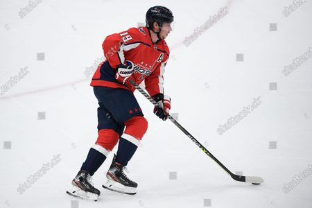 Washington Capitals center Nicklas Backstrom (19) skates with the puck during the second period of an NHL hockey game against the Pittsburgh Penguins, in Washington