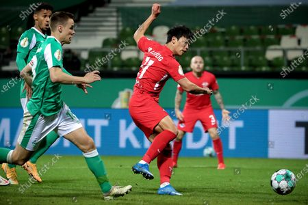 Leipzig's Hee-chan Hwang (R) scores the 1-0 lead during the German DFB Cup semi final soccer match between Werder Bremen and RB Leipzig in Bremen, Germany, 30 April 2021.