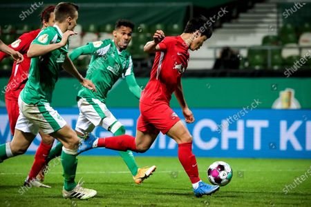 Stock Photo of Leipzig's Hee-chan Hwang (R) scores the 1-0 lead during the German DFB Cup semi final soccer match between Werder Bremen and RB Leipzig in Bremen, Germany, 30 April 2021.