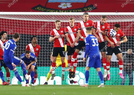 Leicester City's James Maddison shoots at goal from a freekick during the English Premier League soccer match between Southampton and Leicester City at St. Mary's Stadium in Southampton, England