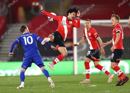 Leicester's James Maddison, left, Southampton's Takumi Minamino, centre, in action during the English Premier League soccer match between Southampton and Leicester City at St. Mary's Stadium in Southampton, England