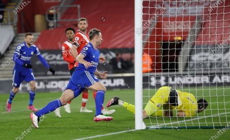 Leicester's Jonny Evans, centre, celebrates after scoring his side's opening goal during the English Premier League soccer match between Southampton and Leicester City at St. Mary's Stadium in Southampton, England