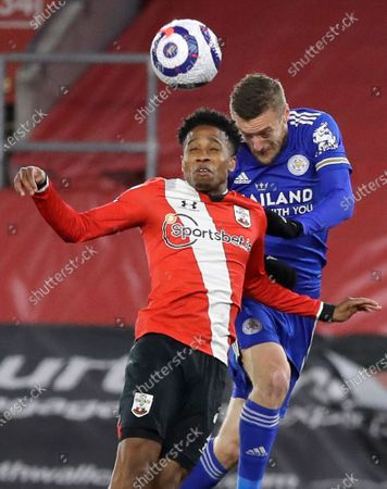 Southampton's Kyle Walker-Peters, left, and Leicester's Jamie Vardy challenge for the ball during the English Premier League soccer match between Southampton and Leicester City at St. Mary's Stadium in Southampton, England