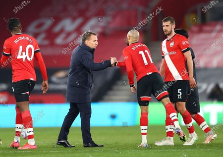 Leicester's head coach Brendan Rodgers congratulates Southampton's players on the pitch after the the English Premier League soccer match between Southampton and Leicester City at St. Mary's Stadium in Southampton, England
