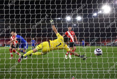 Leicester's Jonny Evans, second left, scores his side's opening goal during the English Premier League soccer match between Southampton and Leicester City at St. Mary's Stadium in Southampton, England