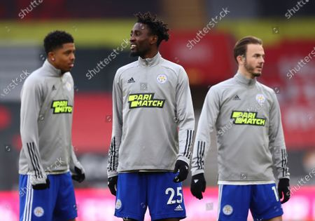 Leicester's Wesley Fofana, left, Leicester's Wilfred Ndidi, centre, and Leicester's James Maddison warm up prior to the English Premier League soccer match between Southampton and Leicester City at St. Mary's Stadium in Southampton, England