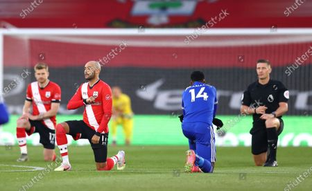 Players take a knee before the English Premier League soccer match between Southampton and Leicester City at St. Mary's Stadium in Southampton, England