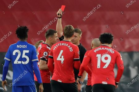 Stock Photo of Referee Robert Jones gives red card to Southampton's Jannik Vestergaard, centre, during the English Premier League soccer match between Southampton and Leicester City at St. Mary's Stadium in Southampton, England